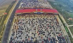 Vehicles are seen stuck in a traffic jam near a toll station as people return home at the end of a week-long national day holiday in Beijing China October 6 Picture taken October 6 REUTERS/China Daily by parismatch_magazine In China, China Trip, Macau, National Day Holiday, Golden Week, New City, Photos Of The Week, Peace Of Mind, Aerial View
