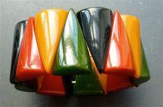 bakelite multicolor triangular rounded stretch bracelett width 1 3/8 in  Price: $1,850.00 from Bakelite Museum
