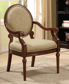Add this elegant taupe arm chair to your home decor. This beautiful arm chair is constructed of solid wood. It has a padded seat and back for extra comfort and support. This chair has an elegant taupe leaf pattern that exudes warm, earthy tones.