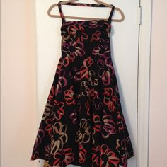 Anthropologie Halter Sundress - Adjustable Strap NWT Floral Anthro sundress with halter-style top. Strap is adjustable (pictured). Skirt has added volume thanks to a flirty purple crinoline underneath. Anthropologie Dresses