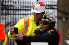 Canada's Prime Minister Justin Trudeau (L) poses for a selfie with a worker following an event marking the completion of masonry work on West Block on Parliament Hill in Ottawa, Ontario, Canada, February 1, 2017. REUTERS/Chris Wattie #Canada #Trudeau