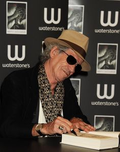 Keith Richards signing charity auction items Charity Fundraising Packages by Charity Fundraising Packages www.charityfundra...