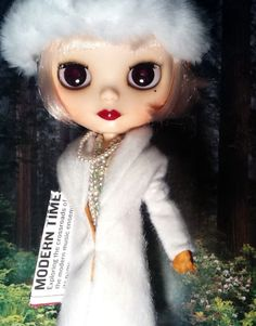 "https://flic.kr/p/rNrCoT | Blythe-a-Day April#21: Tree & #26 Flowers : Pt. 1: Daisy Buchanan Gets a Shock | During the Jazz Age: As Daisy Buchanan went for a walk, she bought a newspaper that she planned to read casually at some point. But first, she wanted to feel the beauty, peace, and contentment of walking through the park with its life-affirming trees and flowers. Yet, Daisy's contemplative walk was completely shattered when she briefly saw the newspaper headline and large photo: ""The…"