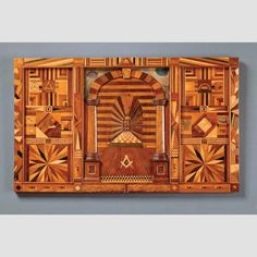 """MASONIC PLAQUE IN THE FORM OF A ROYAL ARCH TRACING BOARD/ Artist unidentified, probably Natick, Massachusetts, 1899, wood with printed and painted paper, 18 3/4 × 31 5/8 × 15/16"""", collection of the American Folk Art Museum, gift of the Hirschhorn Foundation: 1997.6.4.  Photo credit: David Stansbury"""