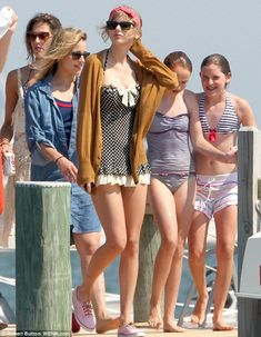 You looks way cute Taylor... :-) #TaylorSwift #fashion #music and #movies   Retro baby: Swift donned a pretty polka dot bathing suit to hit the water