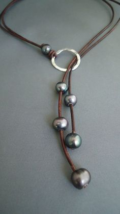Reserve for Maggie-Leather and Black Pearls by IseaDesigns