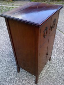 the right hand side of the gramophone cabinet