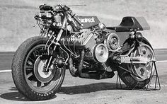Dan Hanebrink built the Monotrack Experimental back in the early 1970s. The monocoque chassis was made from magnesium plate and a three-cylinder, rubber-mounted, two-stroke Kohler snowmobile engine provided power to the belt-driven torque converter. Drive to the rear wheel was also by belt. Very cool.