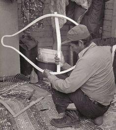 Sam Rabbitskin installing the crossbars in a new pair of beavertail snowshoes, Mistassini , Quebec 1977; from the video ''Beavertail Snowshoes'' ; photo Henri Vaillancourt