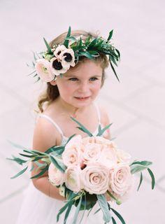 Flower covered cutie! http://www.stylemepretty.com/tennessee-weddings/nashville/2015/07/23/romantic-art-deco-inspired-nashville-wedding/ | Photography: Cassidy Carson - http://www.cassidycarsonphotography.com/