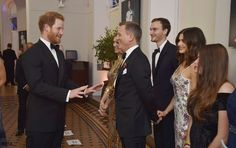 Prince Harry was so excited to meet Daniel Craig he asked him to sign his programme. You'll notice a lovely moment between the star and his wife Rachel Weisz. The actress looked amazing in Alexander McQueen.