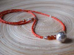 Fine silver lotus bell carnelian and sapphire yoga necklace