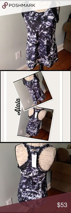 Alala Fitted Tank Water print in size large and one in extra small. Beautiful black purple and white colors. Racer back. Black mesh trim. Large is 26 inches from shoulder to bottom. Extra small is 24 1/2 inches from shoulder to bottom. Scoop neck. Nylon/spandex. Alala Tops Tank Tops