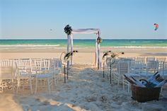 The beach is all set up for the white wedding - Emily & Rishi's destination wedding in Tulum