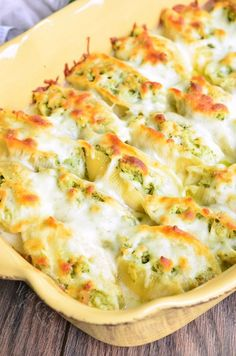 Pasta shells stuffed with a mixture of ricotta cheese and pesto chicken, baked in a simple white sauce, and topped with extra Mozzarella cheese.