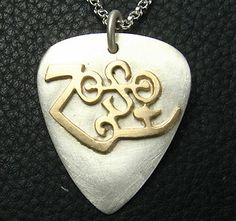 sell-jewelry.joanjewelry.com/pic/66/mjg-silver-10ky-zoso-guitar-pick-pendant-jimmy-page-led-zeppelin.jpg