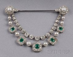 Emerald, Diamond, and Seed Pearl Drapery Brooch, Cartier | Sale Number 2496, Lot Number 659 | Skinner Auctioneers