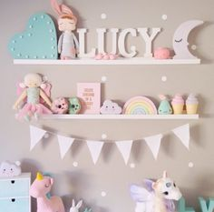 Pastel colours + cute ornaments on shelving
