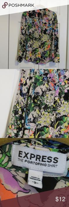 """Express Portofino Shirt Sz Small Floral Black Work Women's Express Portofino shirt size small. Very pretty black, white, green, blue, yellow, neon orange, and purple floral print. Measures approx. 20"""" from underarm to underarm and 25"""" from shoulder to hem. 100% polyester. Machine wash cold gentle. Line dry. Express Tops Blouses"""