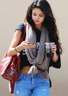 Selena Gomez - Winter Clothing clack top + nude infinity scarf + red bag + light wash jeans + messy curls