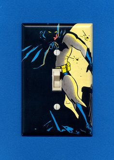 Batman, beacon of hope in a dark room. Custom-made lightswitch plate. Visit my Etsy shop for more or to request your own!