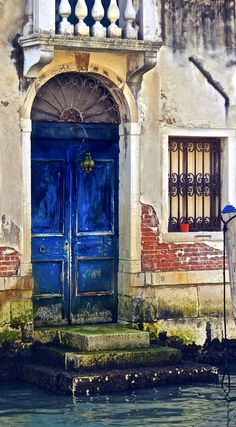 Water door by David Valansi  |  Venice, Italy is one of my all time favorite places to visit...the water lapping at doors which are peeling layers of paint, the crumbling brick, the moss covered stone and the windows with balconies ... it has a unique beauty...
