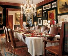 Ralph Lauren's dining room in his Bedford, New York manor. From right, A Woman Hunting, 19th century, by Alfred Dereux; Henry Koehler's 1927 Hunting Coats and Whips of the Pytchley Hunt Staff and Piebald Horse in a Field, 19th century, by Thomas Moyford. Ralph Lauren Home flatware.