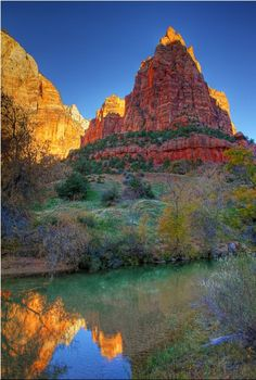Gaze up at massive sandstone cliffs of cream, pink, and red that soar into a…