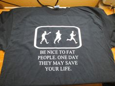 Black gildan t shirt with be nice to fat people on the front