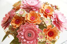 The buttons look great on these beautiful paper flowers. #buttons #pinitparty