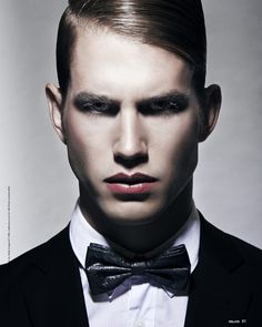 Model André Hamann posing for a striking Belane portrait series snapped by Krystina Woldanowski.