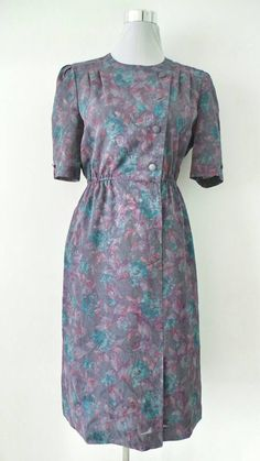 Check out this item in my Etsy shop https://www.etsy.com/uk/listing/272487366/80s-floral-side-button-vintage-dress