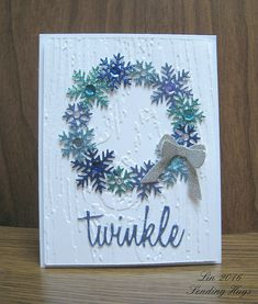 Glitter paper snowflake punched wreath; wood grain embossing folder