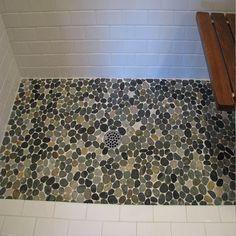 Large sliced bali ocean pebble in white tile shower Pebble Tile Shower, Pebble Shower Floor, White Tile Shower, Bathroom Floor Tiles, Bali, Bathroom Store, Master Bathroom, Bathrooms, Shower Pics