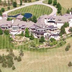 By far one of the LARGEST homes I have ever posted! This 50,000 square foot mega mansion features 5 floors, 2 elevators, a spa, movie theater, gym, 10 car garage, indoor pool, and much much more 25% of the mansion didn't even fit in this picture... (Serenity Ridge - 10687 Evans Ridge Road, Parker, Colorado)