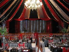 Red, black and white draping with fairy lights is a lovely touch for burlesque and Hollywood themed event.