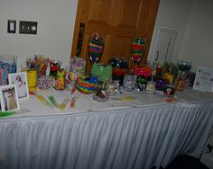 We did a candy bar (for the wedding favor) using candy in the colors of the wedding flowers. We also had Caramel apples made that look like tux's and wedding dresses.