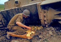 A US Army Corps of Engineers solider packs pound tins of the explosive TNT under one end of an abandoned Tiger Tank in preparation for detonation during military operations in the El Guettar Valley, Tunisia, early Afrika Corps, Army Corps Of Engineers, Ww2 Photos, Team Photos, Tiger Tank, Military Operations, History Books, Ww2 History, Vietnam War