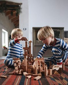 """Wooden Story on Instagram: """"Lovely photo from @growingwildthings ❤️: """"Still in our jammies, waiting for the sun to make her appearance from behind the thick morning mist, and keeping ourselves very, very busy building wooden towers {and knocking them over}..."""" ☺️ #morningslikethese #naturalplay #childhoodunplugged #woodentoys #woodenblocks #woodenstory #ecotoys #greentoys #peaceandloveblocks #natural #blocks #fsccertified #loveearth #growingwildthings"""""""
