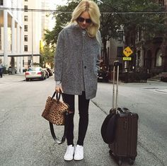 A gray coat is kept casual with destroyed black denim and white sneakers. // #StreetStyle