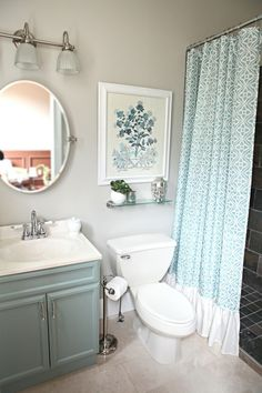 Small bathroom makeover. Love the turquoise cabinets and would do grey walls. Master bath. Also like the ruffle on bottom of shower curtain.