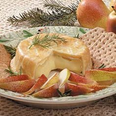 BAKED BRIE 1/4 cup butter, softened 1 package (3 ounces) cream cheese softened 3/4 cup all-purpose flour 1 round (8 ounces) Brie cheese 1 egg 1 teaspoon water