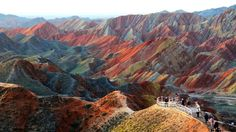 China Gansu Province Zhangye (24 million years of vibrant stone and mineral deposits have created rainbow-striped mountains.The tinted peaks were fashioned by uplift from the Earth's tectonic plates – the same ones that formed parts of the Himalayan range – while rain, wind and erosion shaped them into the jagged world seen today.)