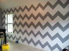 Baby boys room with accent chevron wall