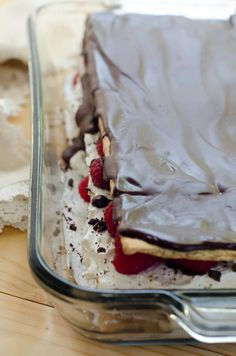 A traditional icebox cake dressed up with layers of sweetened mascarpone and fresh raspberries and topped with a rich, dark chocolate ganache! A beautiful and delicious summer dessert. ~ http://www.fromvalerieskitchen.com