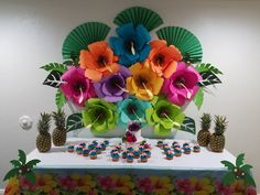 Hibiscus paper flowers backdrop. Hawaian party.
