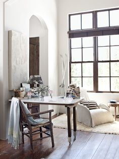 Smart idea: A marble counter tops a desk in this study. #whitedecor
