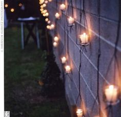 Over 200 white candles -- hanging in clear glass cylinders, surrounding the centerpieces, and floating in the swimming pool --set a romantic scene.