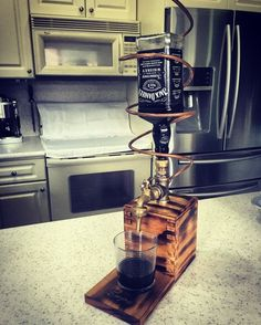 Copper and stained wood liquor dispenser. Perfect for the home bar or man cave. They are made from stained wood and copper pipe. They hold a standard 750 ml bottle if your favorite alcoholic beverage. Whiskey Dispenser, Alcohol Dispenser, Beverage Dispenser, Whisky Spender, Homemade Liquor, Bottle Wall, Liquor Bottles, Handmade Wooden, Industrial Furniture