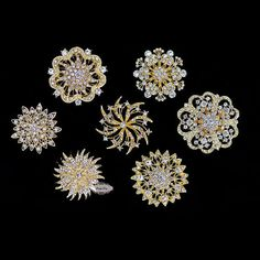 14pc Set - 2 of each brooch shown Rhinestone Brooches as shown. We reserve to replace one or more brooches from the set if any become temporarily sold out. Perfect for Bridesmaid Gift or Bridesmaid Je